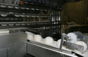 Dough exiting riser